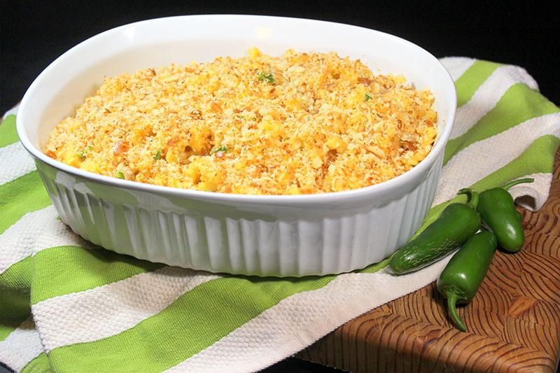 Jalapeño Macaroni and cheese in white dish.