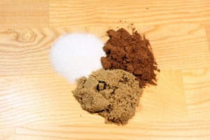 Sugar, Cocoa Powder and Brown Sugar on wood background.