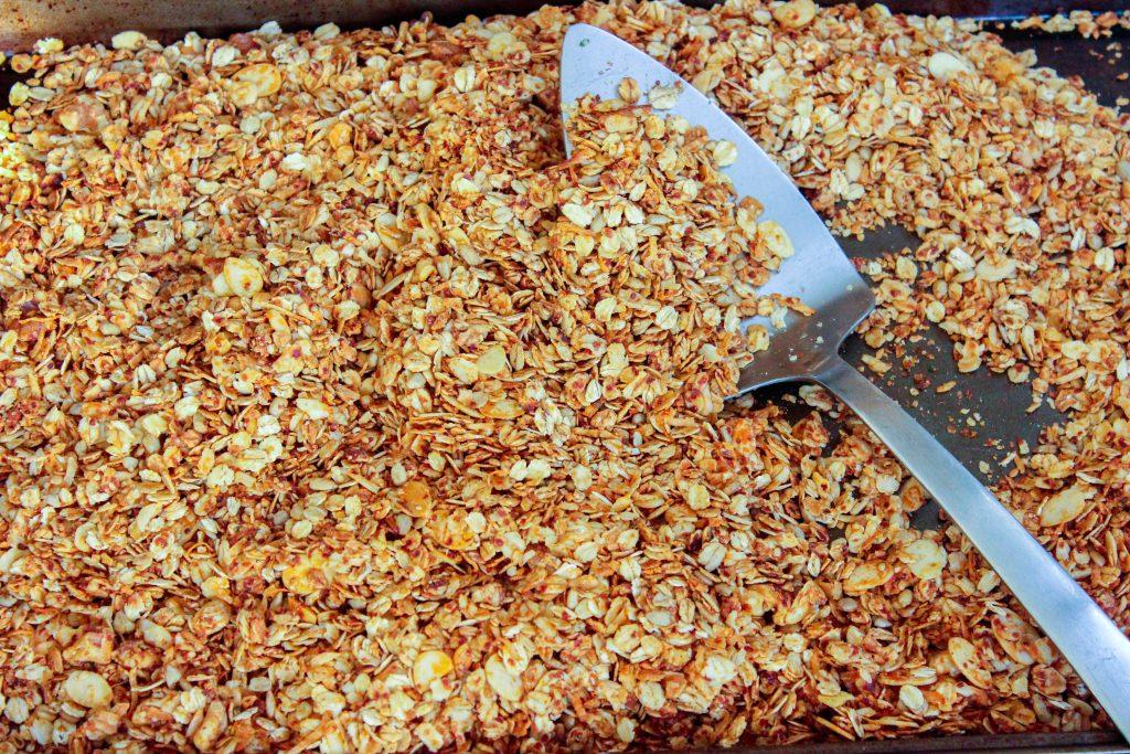 Baked granola on sheet pan.
