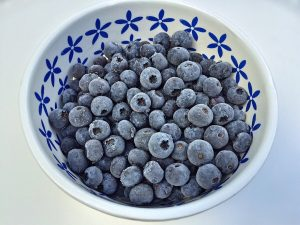 Blueberries in White and Blue Bowl.