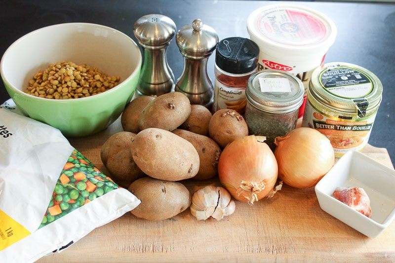 Vegetarian Shepherd's Pie Ingredients on Wooden Board.