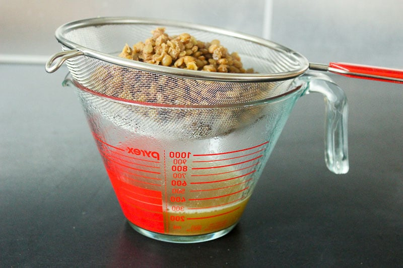 Straining Lentils in Glass Measuring Cup.