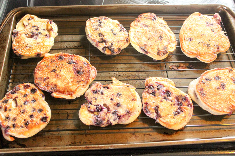Healthy Blueberry Pancakes cooling on wire rack on sheet pan.