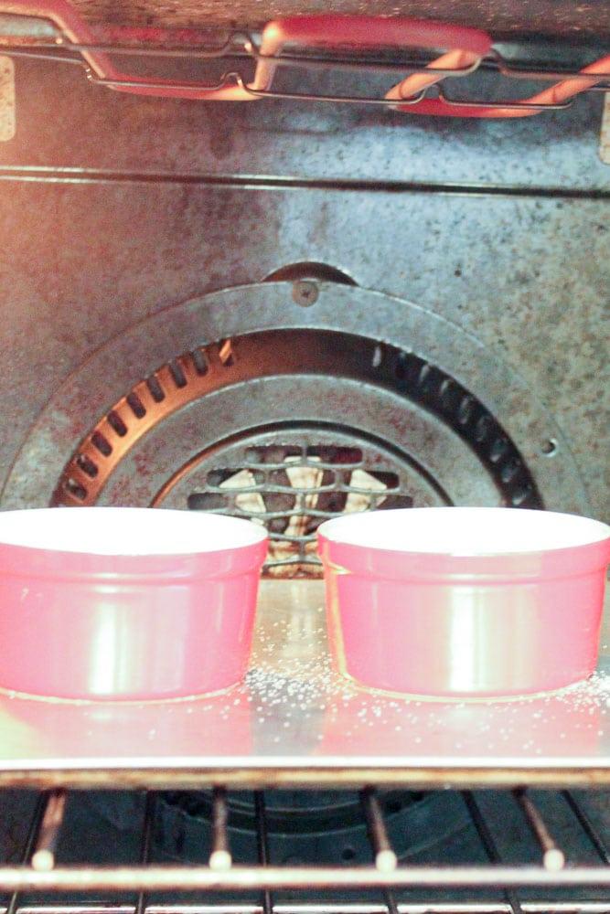 Creme Brûlée in Red Ramekins in Oven.