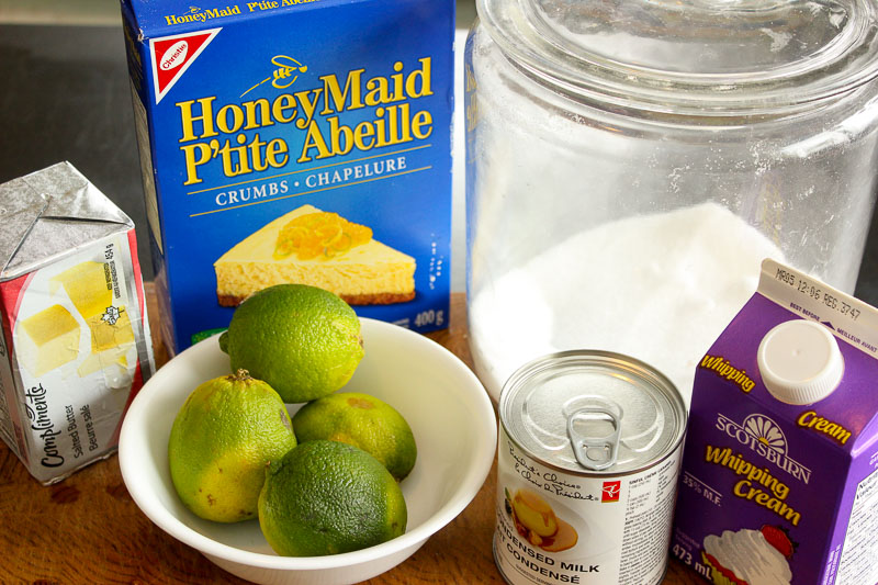 Key Lime Pie Ingredients on Wooden Board.