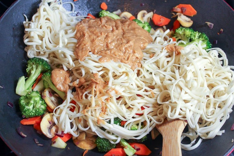 Vegetables, noodles and brown sauce in wok.