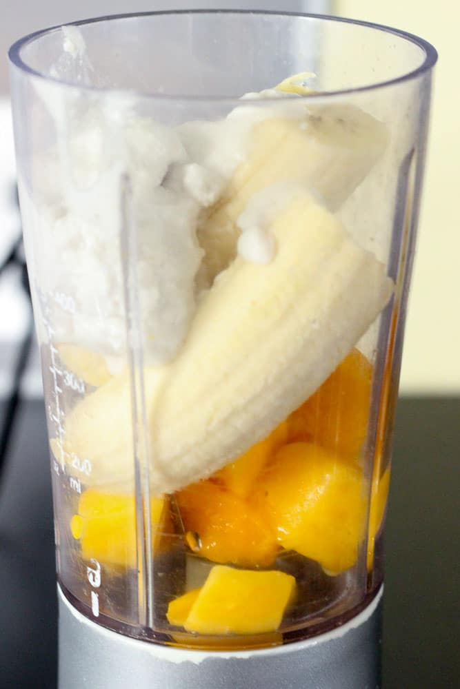 Bananas, Mango and Coconut Milk in Blender.