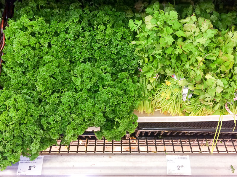 Fresh Parsley and Cilantro at Grocery Store.
