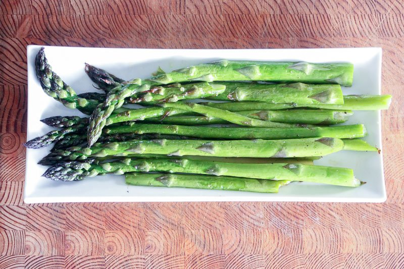 Roasted Asparagus on White Plate.