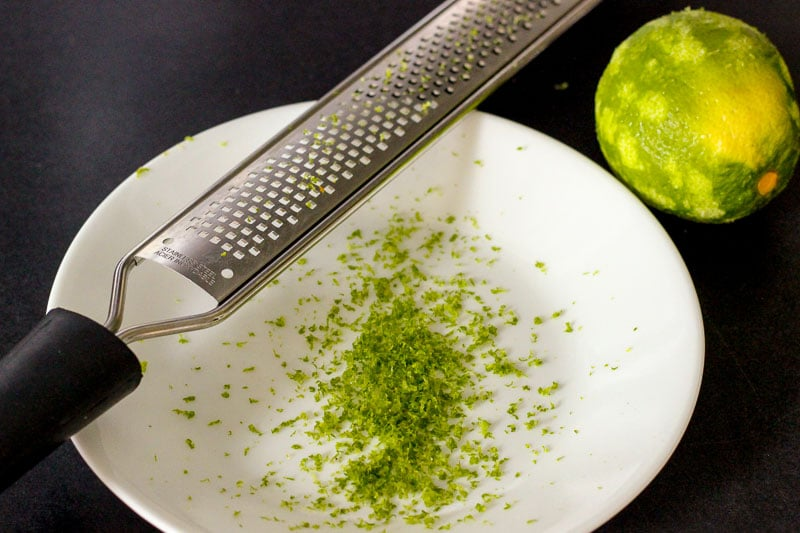 Lime Zest on White Plate.