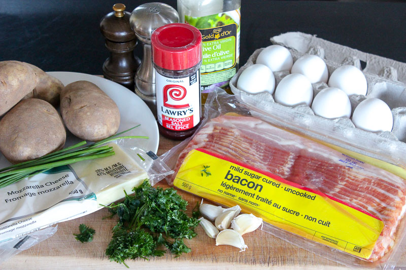 Potato, Bacon and Egg Sheet Pan Breakfast Ingredients on Wooden Board.
