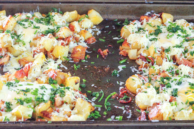 Potato, Bacon and Egg topped with Cheese and Parsley on Sheet Pan.