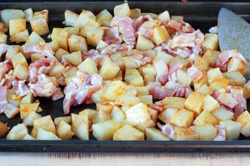 Cubed Potatoes and Chopped Bacon on Sheet Pan.