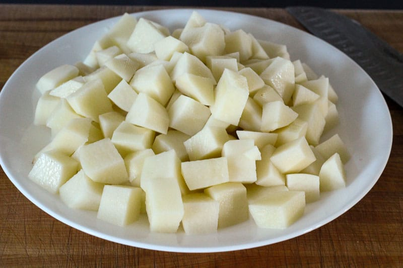 Cubed Potatoes on White Plate.