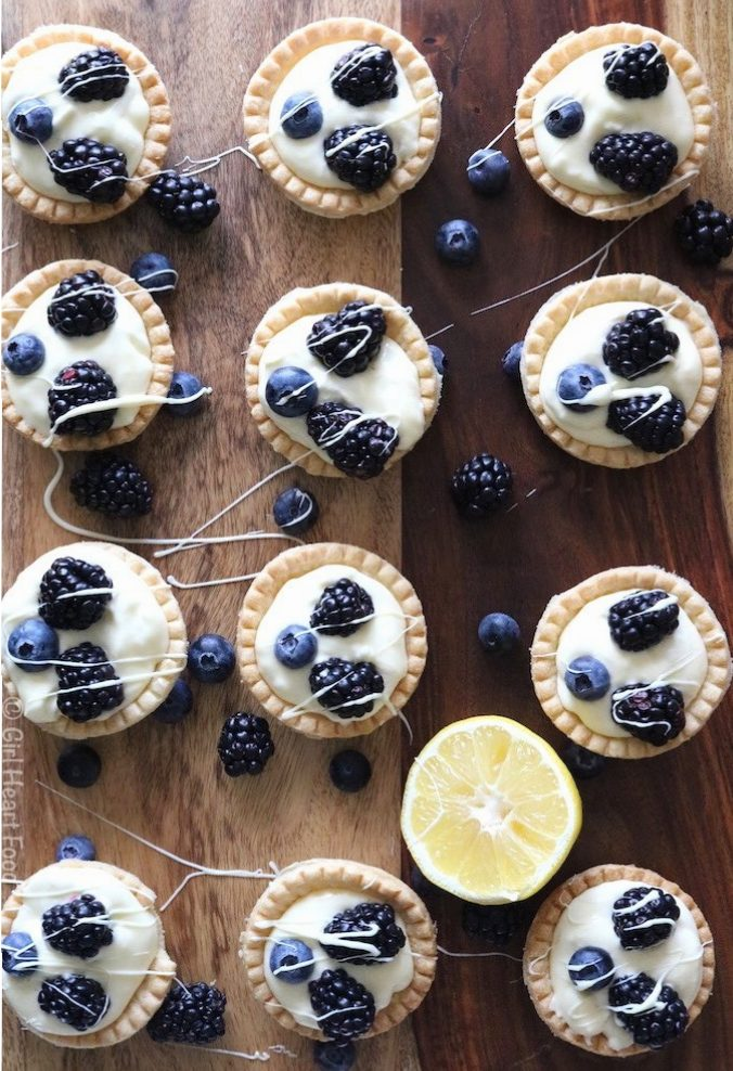 Lemon Cream Tarts topped with blackberries and blueberries.