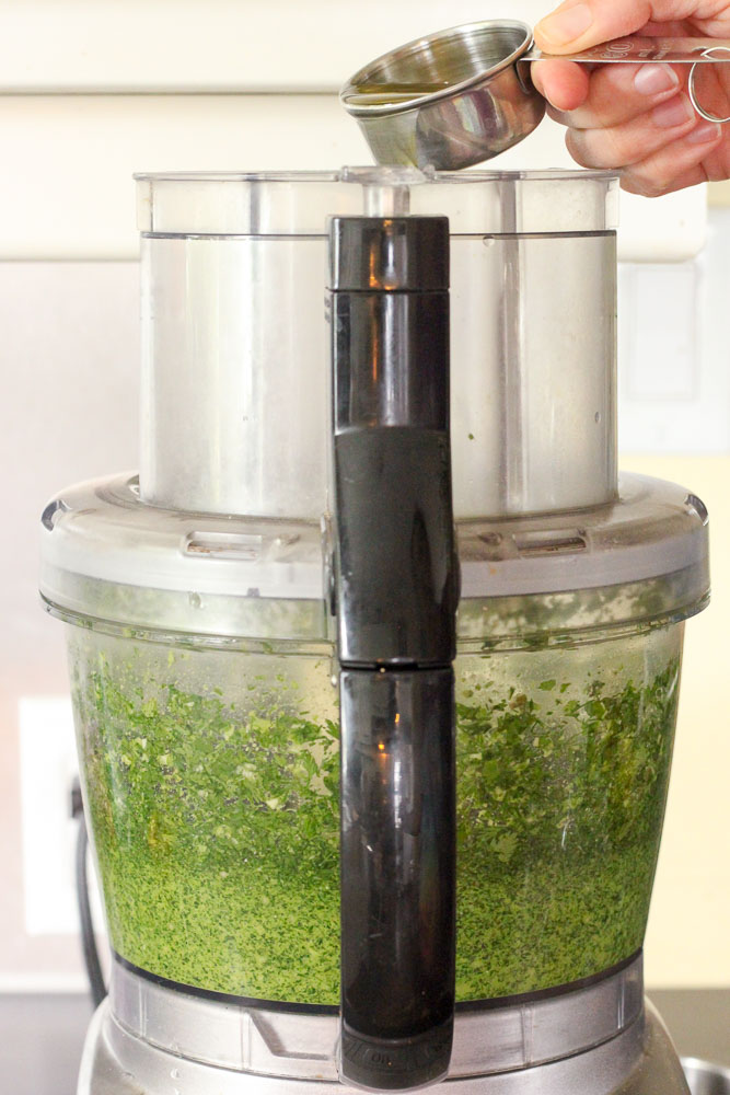 Adding Olive Oil to Food Processor.