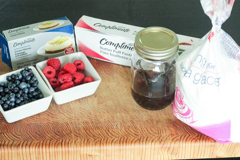 Berry and Cream Cheese Pastries Ingredients on Wooden Board.