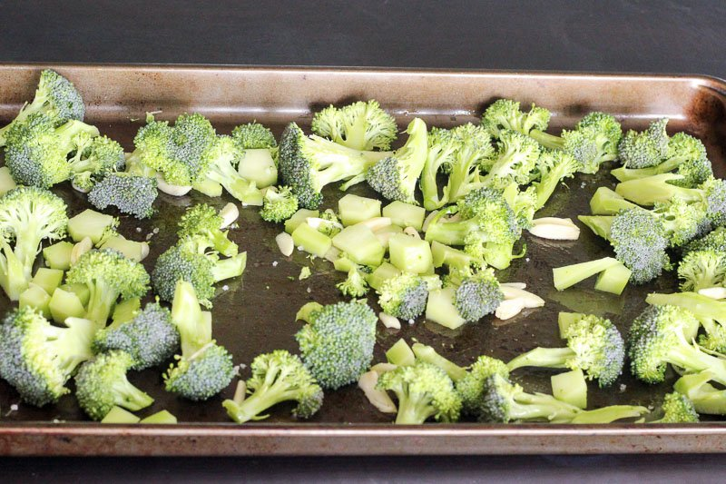Chopped Broccoli and Garlic on Baking Sheet.