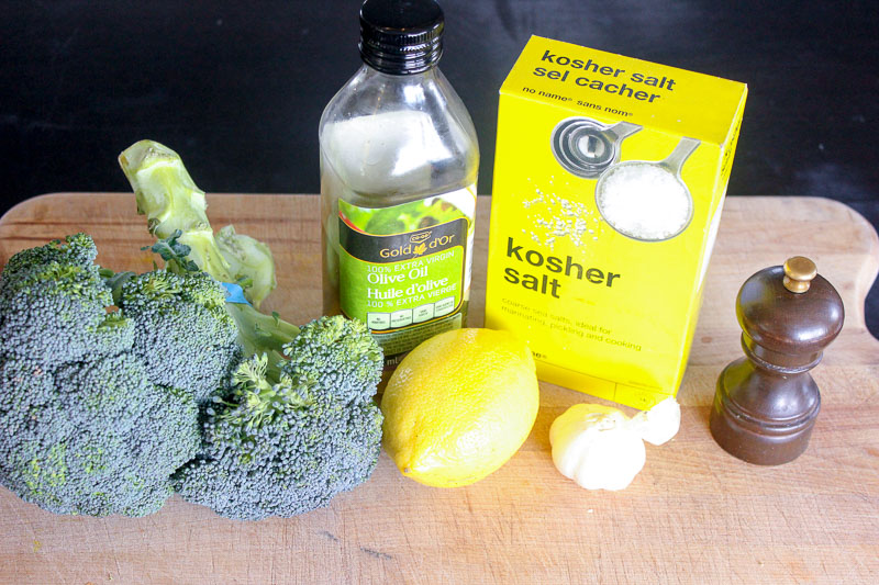 Oven Roasted Broccoli Ingredients on Wooden Board.