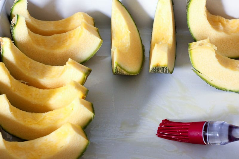 Sliced Squash on Oiled Parchment Paper.