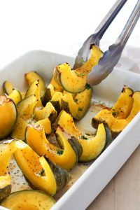 Oven Baked Maple Squash in White Baking Dish.