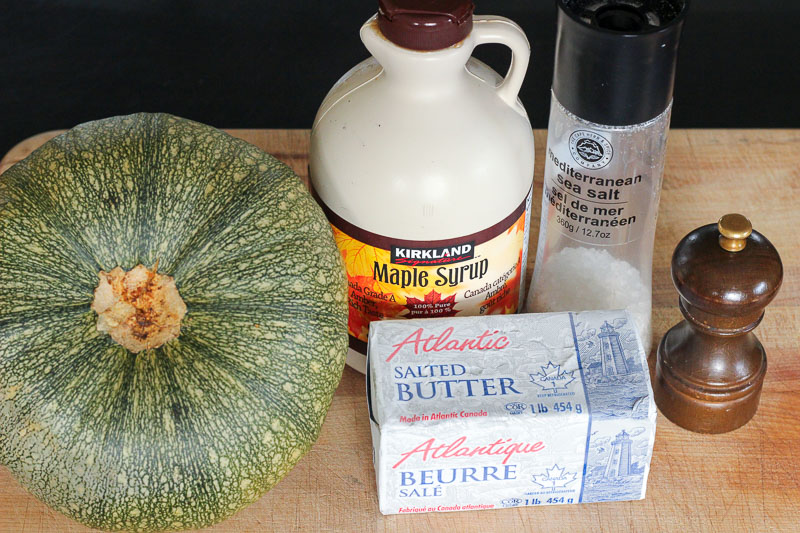 Oven Baked Maple Squash Ingredients on Wooden Board.