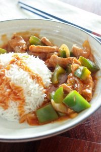 Sweet and Sour Pork Stir Fry and Rice in White Bowl.
