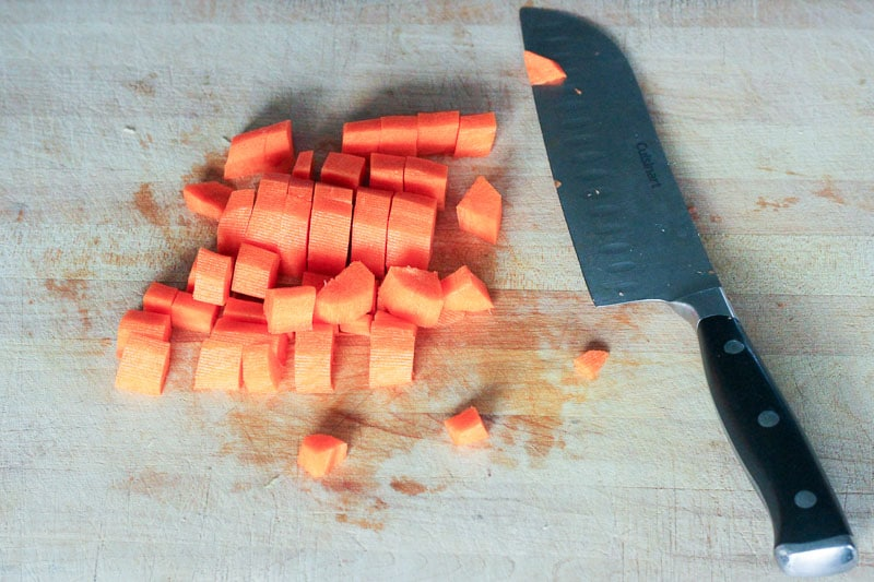 Chopping Carrots on Wooden Board.