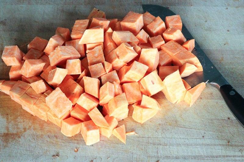 Chopping Sweet Potato on Wooden Board.