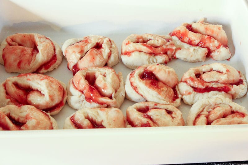 Set rolls in pan to rise for Strawberry Sweet Rolls with Vanilla Cream Cheese Icing