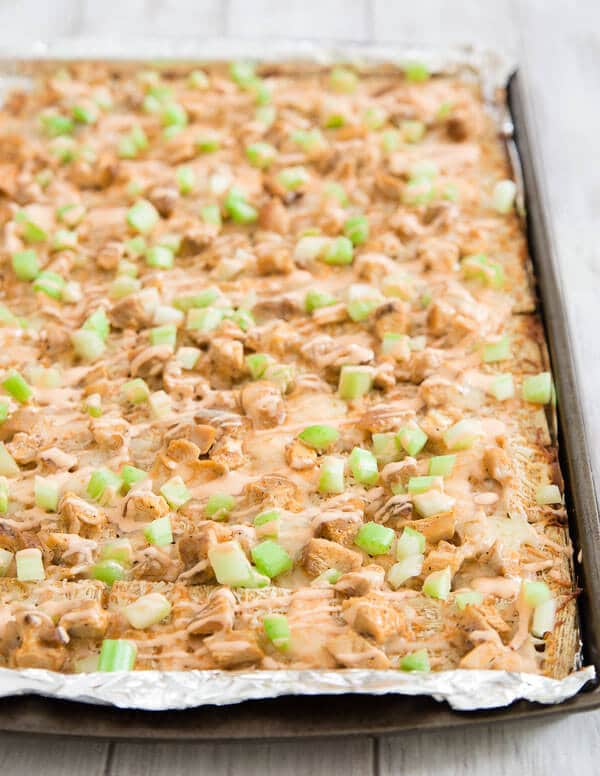 Triscuit Crackers topped with Chicken, Celery and Brown Sauce in Sheet Pan.