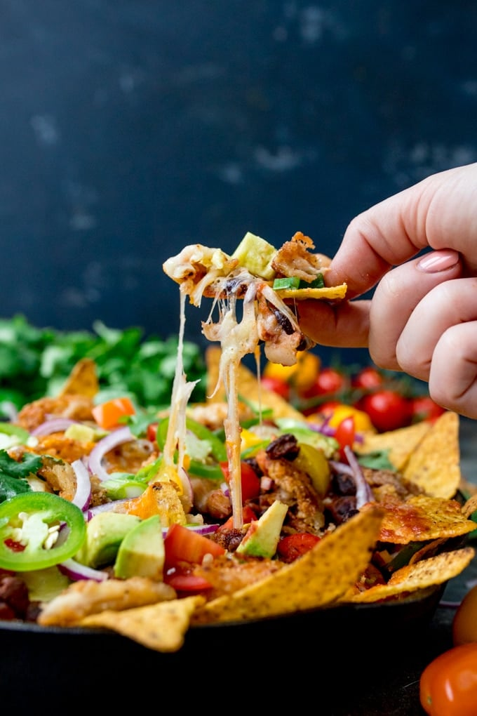 Nacho Chips topped with Tomatoes, Jalapeños, and Cheddar Cheese.