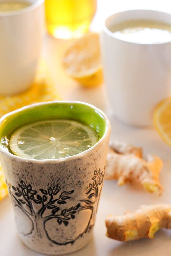 Lemon and Ginger Drink in White and Green Mug.