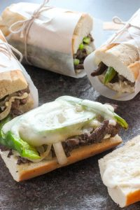 Steak Sandwich with Garlic, Onions and Peppers - from our $5 Meals e-book. These $5 Meals are the answer to your wish for groceries on a budget! Easy recipes and simple tips mean that frugal meals can still be amazing! Check out these recipes if you've ever wanted to save money on groceries!