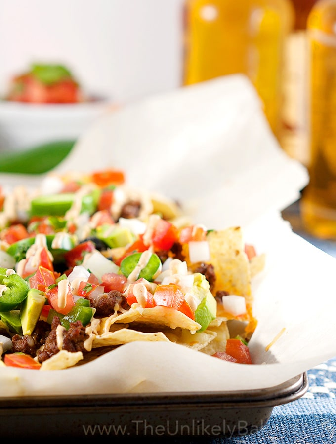 Nacho Chips topped with Tomatoes, Jalapeños, Avocado and Ground Beef.