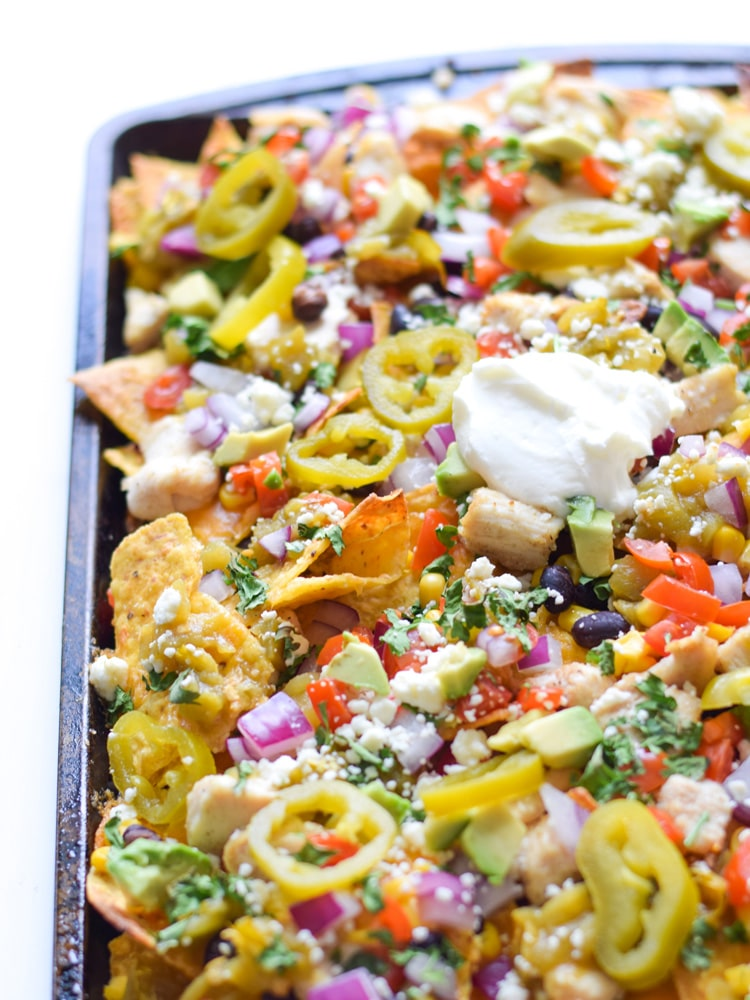 Nacho Chips topped with Jalapeños, Red Onion, Avocado, Black Beans, Tomatoes and Sour Cream.