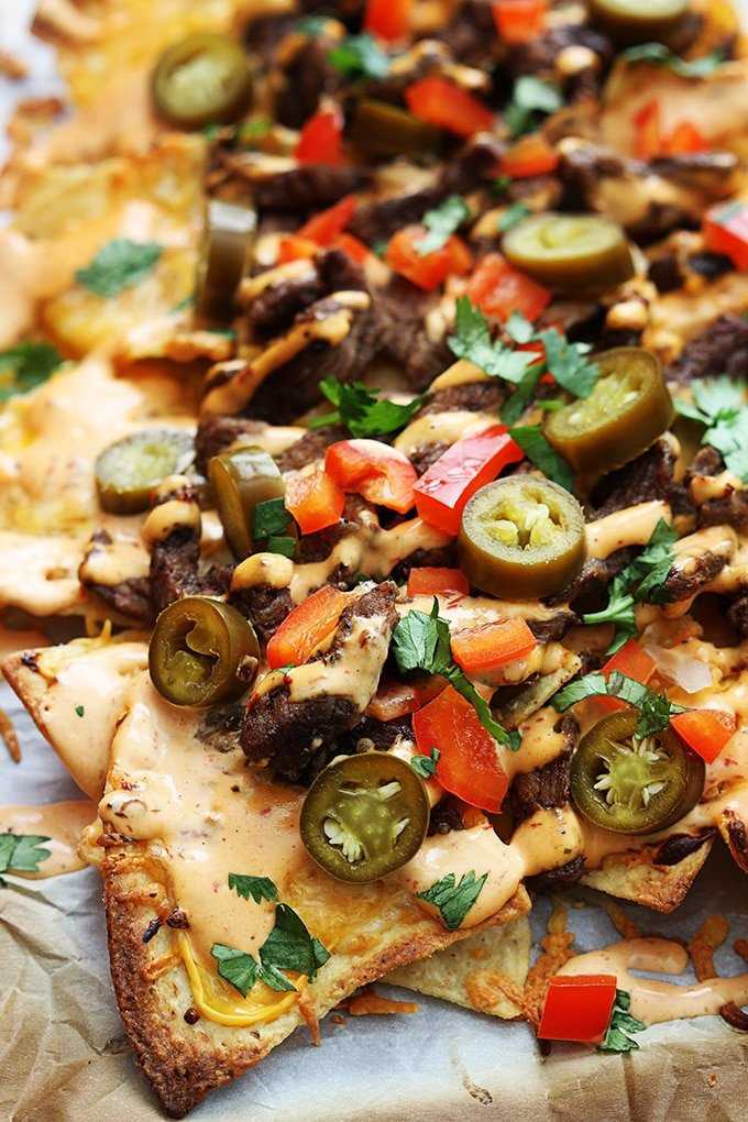 Steak Nachos topped with Jalapeños, Red Peppers and Cilantro.