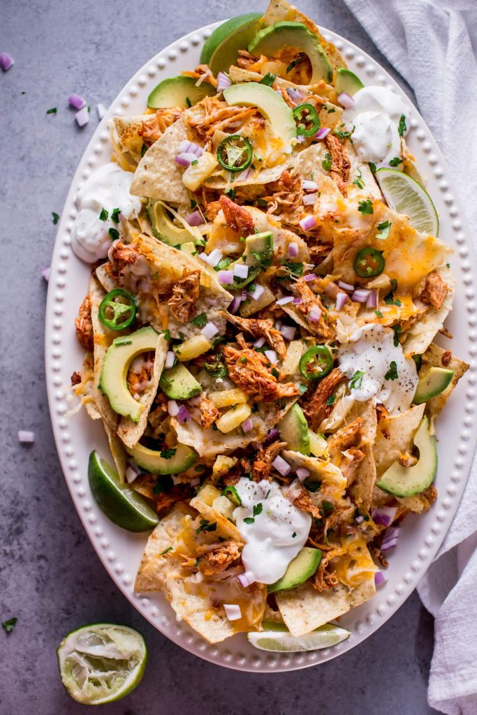 Nacho Chips topped with Avocado, Shredded Meat, Jalapeños and Sour Cream.