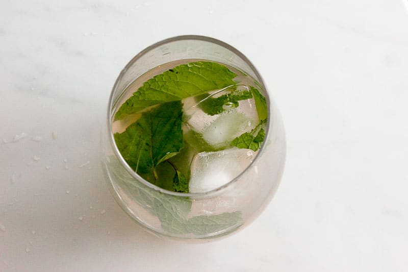 Glass with Ice Cubes and Mint Leaves.