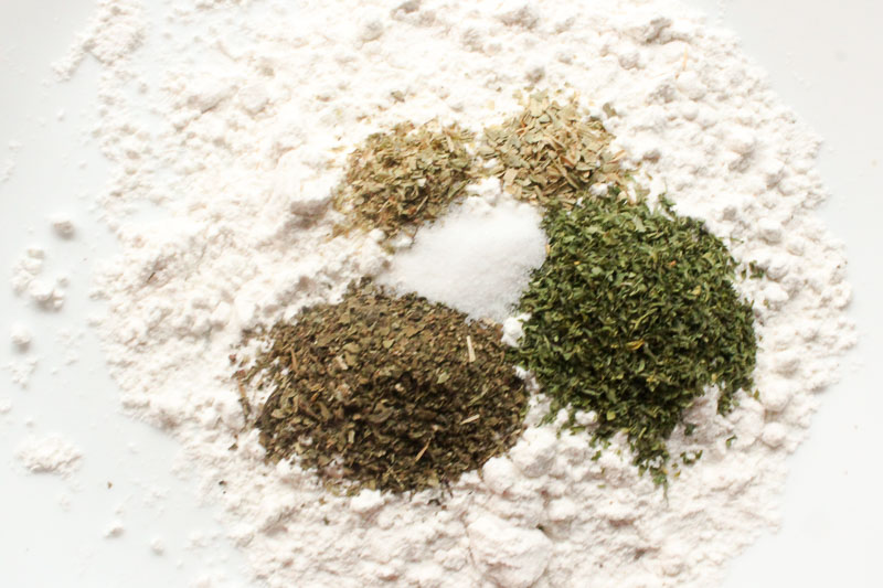 Flour and herbs for Creamy Chicken Skillet with Sun Dried Tomatoes and Italian Herbs