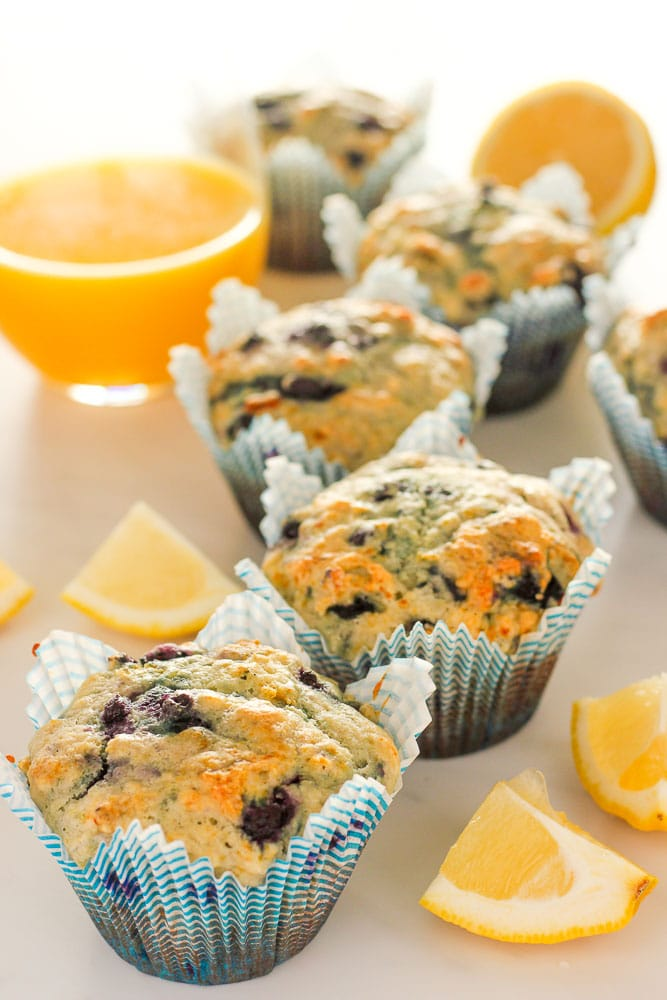 Lemon blueberry muffins with a glass of orange juice