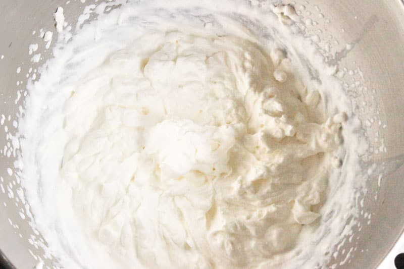 Whipping Cream in Metal Bowl.