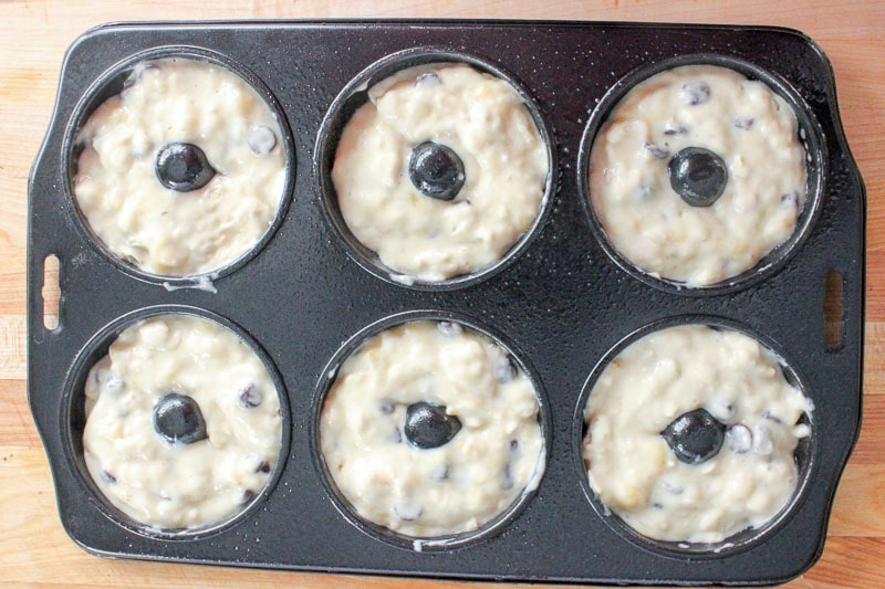Fill donut pan for Healthy Donuts with Banana and Chocolate Chips