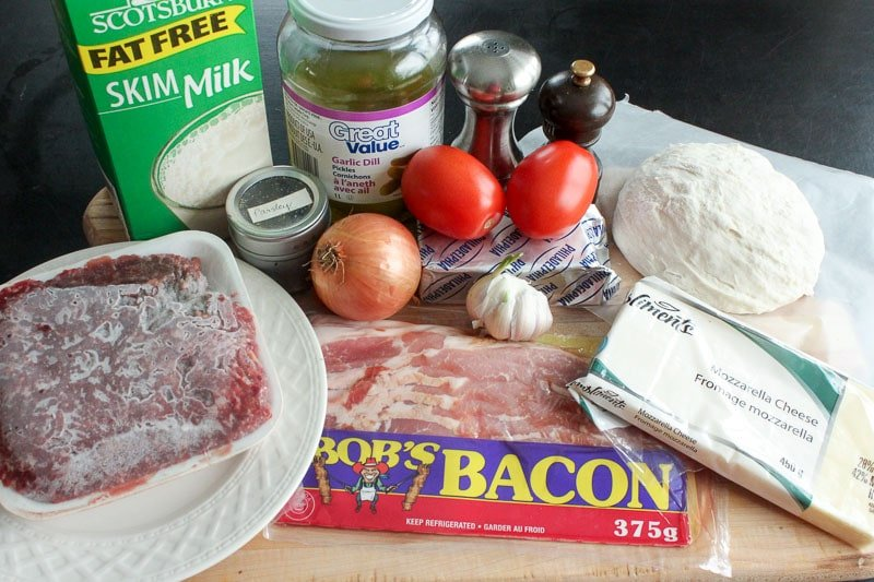 Homemade Bacon Cheeseburger Pizza Ingredients on Wooden Board.