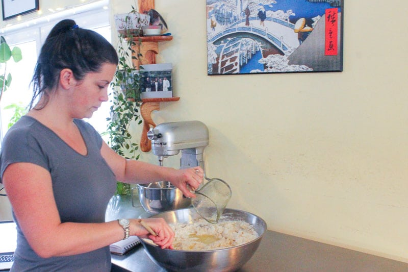 Woman Mixing Pizza Dough in Metal Mixing Bowl.
