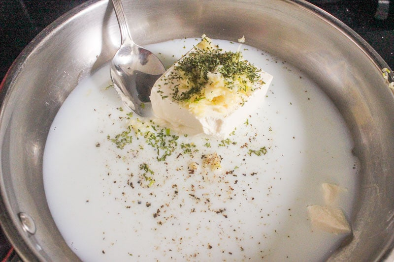 Cream Cheese Milk and Herbs in Frying Pan.