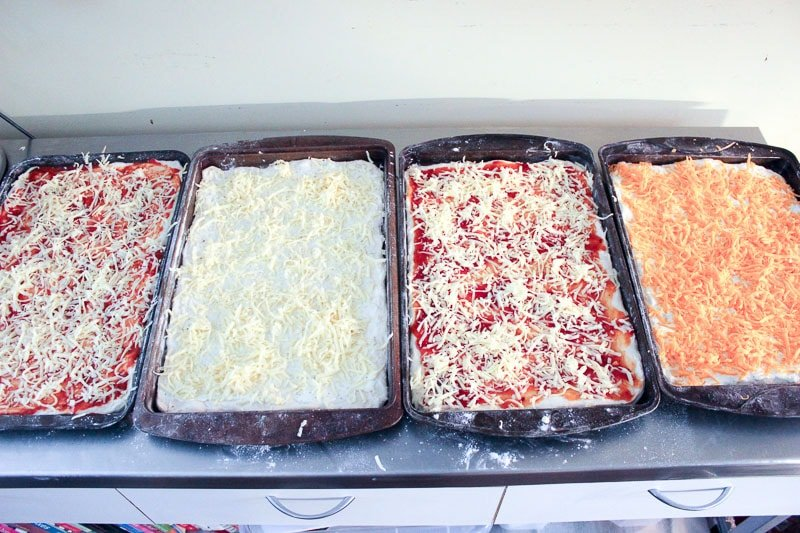 Top sauce with cheese for Homemade Freezer Pizza - Easy Freezer Meals