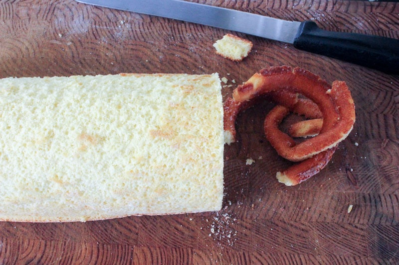 Cake roll with overcooked edges trimmed off