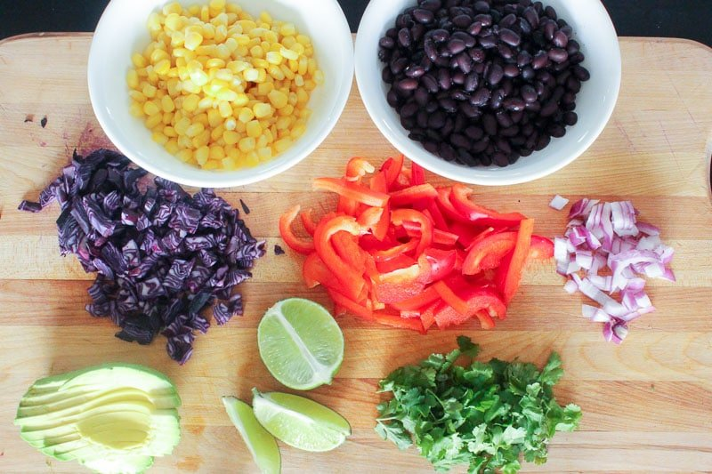 Mexican Buddha Bowl Ingredients on Wooden Board.