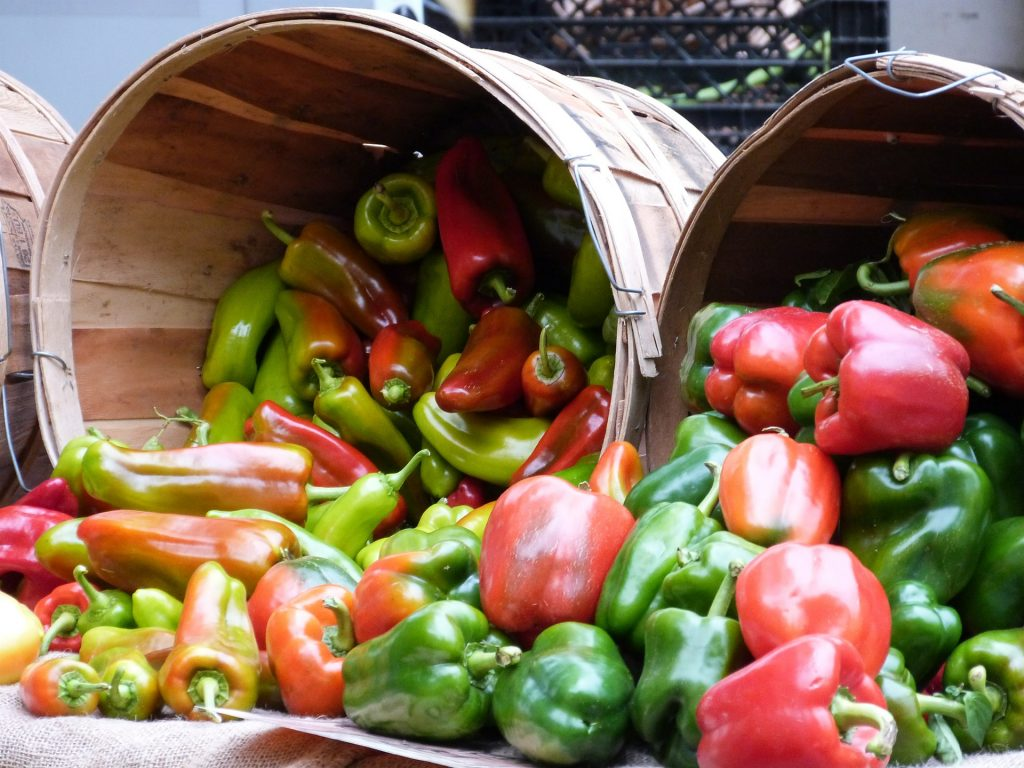 Wooden Baskets Filled with Red and Green Peppers.
